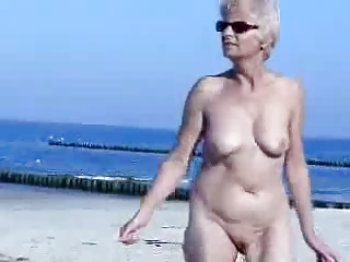 Must see this cute granny totally naked at beach