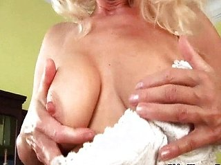 Mature blonde in stockings masturbates