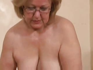 Gorgeous mature slut jerking young cock. Amateur older