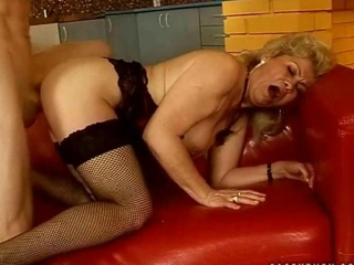 Naughty granny gets fucked rough in her fishnet stockings