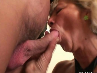 Hot granny agrees to suck his horny cock