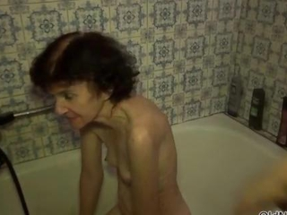 Nasty old woman gets her naked body washed