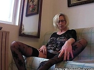 Mature in stockings fists her hairy cunt