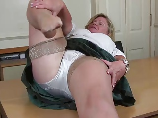 Big breasted mature battle-axe playing with herself